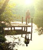 Hombre en el lago — Foto de Stock
