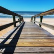 Boardwalk on beach — Stockfoto