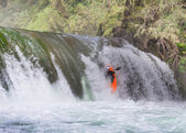Kayaker in waterfall — Stock Photo