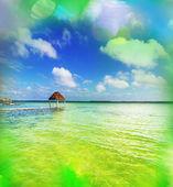 Palapa on water — Stock Photo
