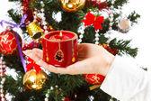 Decorating christmas tree — Stock Photo
