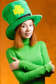 Red hair girl in Saint Patrick's Day party hat — Stock Photo