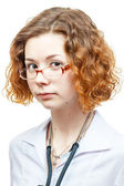 Cute redhead doctor in lab coat with glasses — Stock Photo