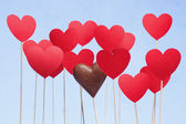 Valentine's day hearts on a stick with chocolate heart — Stock Photo