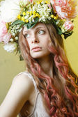 Pretty girl with flower crown on head — Stock Photo