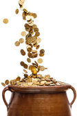 Gold coins falling in the vintage pot — Stock Photo