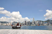 Hongkong victoria sea harbour with wood pavement footpath. — Stock Photo