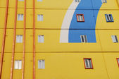 Yellow wall of apartment house — Stock Photo