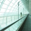 Long airport corridor with escalator — Stock Photo