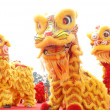 Chinese playing lion dance celebrating the coming new year. — Stock Photo