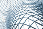 Modern building with curving roof and glass steel column. — Stock Photo