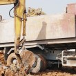 Backhoe loading a dump truck — Stock Photo #27836547