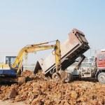 Backhoe loading a dump truck — Stock Photo #27836885
