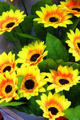 A bunch of man made yellow sunflowers — Stock Photo