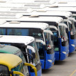Tourist buses on a parking expect passengers — Stock Photo
