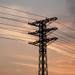 Electricity pylon with long lines in the sunset. — Stock Photo