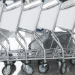 Row of trolleys in a supermarket — Stock Photo