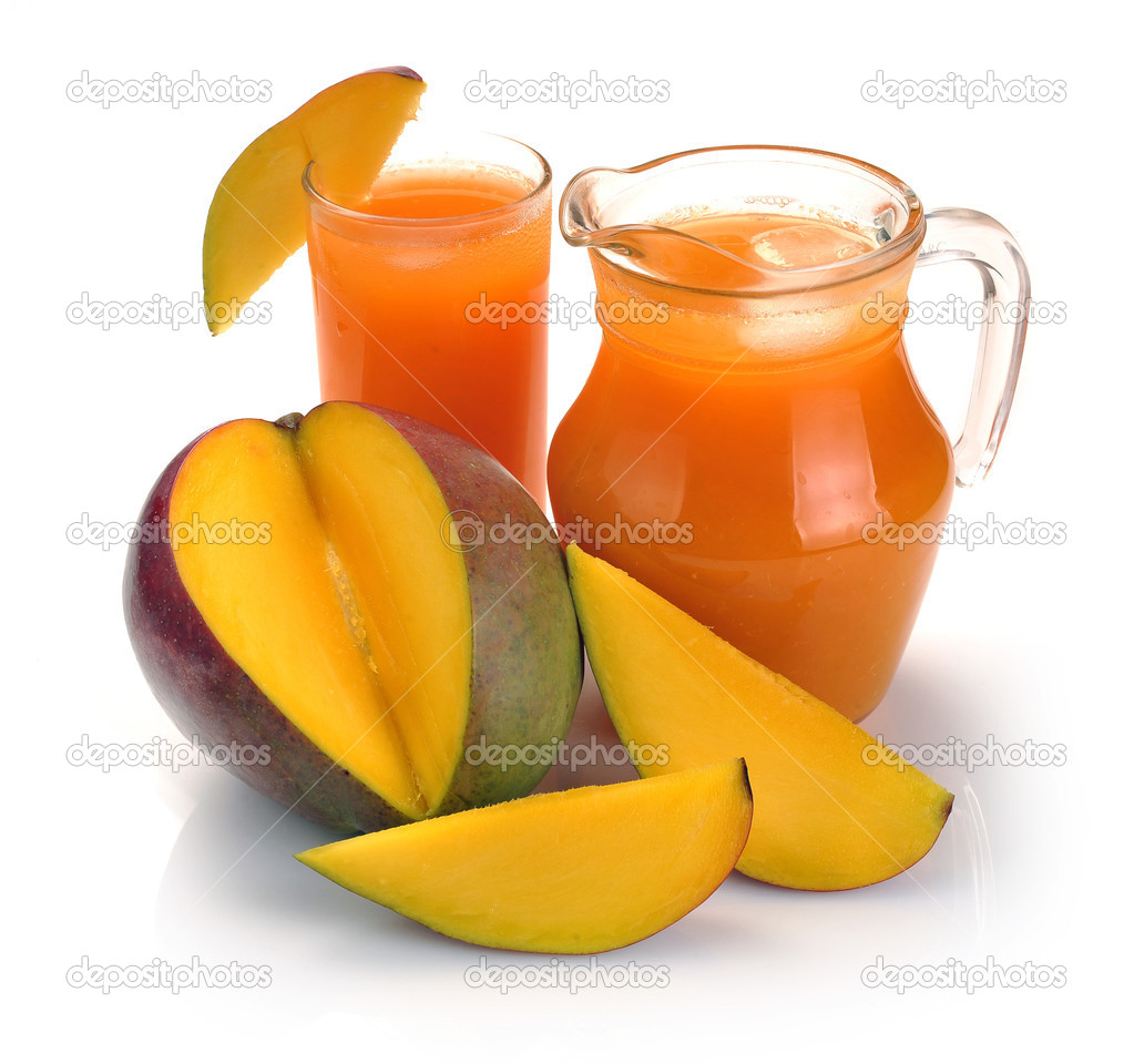Mango juice in a jug and a glass of fruit — Stock Photo #12271782