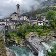Swiss village in the mountains - Stock Photo