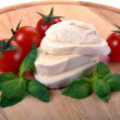 Mozzarella cherry tomatoes basil - Stock Photo