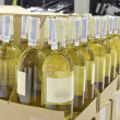 White wine in bottles — Stockfoto