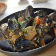 Rapana and mussels in tomato sauce — Stock Photo