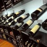 Wine bottles in shop of spirits — Stock Photo #32481397