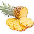Pineapple and its slices — Stock Photo