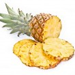 Stock Photo: Pineapple and its slices