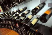 Wine bottles in shop of spirits — Stock Photo