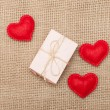 Stock Photo: Three hearts and pink gift box