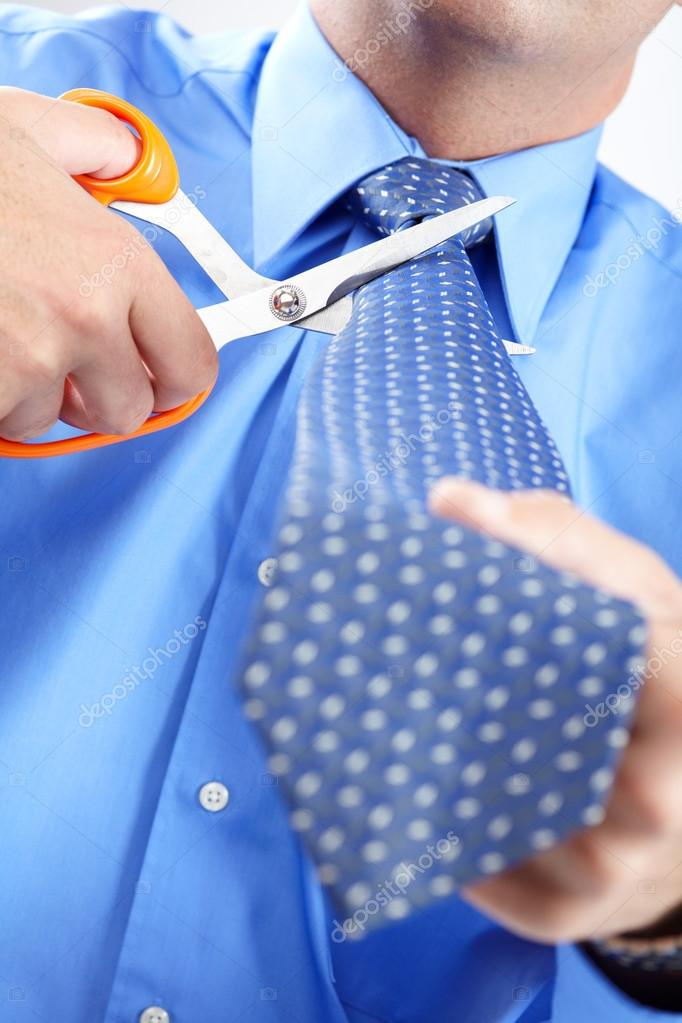 Businessman cutting the tie by scissors at office — Stock Photo #12966710
