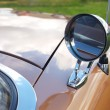 Rear-view mirror of retro car - Stock Photo