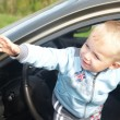 The boy looks out from the automobile — Stock Photo #13918111