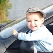 The boy looks out from the automobile — Stock Photo #13918116