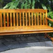 Wooden bench is in a green park — Stock Photo