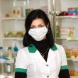 Doctor at pharmacy - Stock Photo