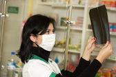 Female doctor examining an x-ray — Stock Photo