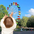 The small girl and Ferris wheel — Stock Photo #23224540