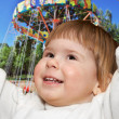 The small girl and Ferris wheel — Stock Photo #23227056