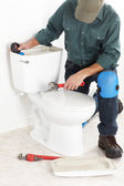 The worker with a plunger — Stock Photo