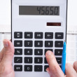 Royalty-Free Stock Photo: The businessman and calculator