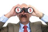 Dollar. The businessman and binoculars — Stock Photo