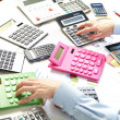Stock Photo: Businesswomand calculators