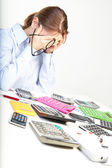 Businesswoman sits at office near calculators — Stock Photo