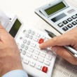 图库照片: Businessmand calculators