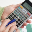 Stock Photo: Businesswomworking with calculator