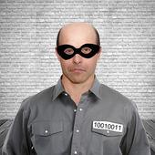 Criminal in prison cell — Stock Photo