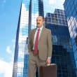 Stock Photo: Businessman and skyscrapers