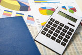 Calculator and documents and money on a business background — Stockfoto